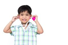 The litter boy is wearing the stethoscope. The litter boy is wearing the stethoscope, with isolate white background Royalty Free Stock Photography