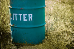 Litter can. Close-up of litter can against muted grass background Royalty Free Stock Photos