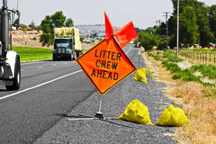 Litter Crew Ahead. Along the roads there are people picking up litter. This crew has a warning sign for the highway traffic. Please don't litter Stock Photos