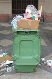 Litter. Overflow of Litter Garbage in Plastic Bin Stock Photos