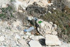 Litter on the seaside stock images
