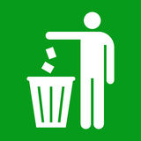 Litter sign. Figure of person throwing garbage into a trash can on green background Stock Photo