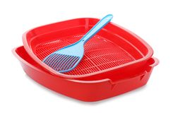 Litter tray and scoop for cat on white background. Pet accessories royalty free stock photo