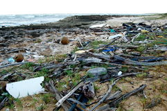 Littered Beach. A remote beach in Hawaii is littered with trash that threatens the lives of local marine animals Stock Photos