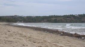 Littered ocean shore. Dirty beach stock video