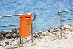 Littering the beach and the sea. Royalty Free Stock Photo
