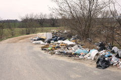 Littering. Garbage dump next to a road Stock Image