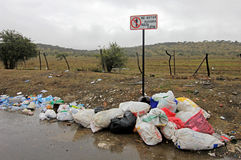 Littering of garbage in front of do not litter sign, Chile. South America Royalty Free Stock Image