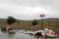 Littering of garbage in front of do not litter sign, Chile. South America Stock Image
