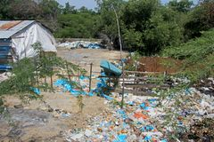 Littering of garbage in front of private houses along colombian coast, Santa Marta, Columbia. South America Royalty Free Stock Photo