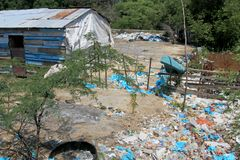 Littering of garbage in front of private houses along colombian coast, Santa Marta, Columbia. South America Stock Photo