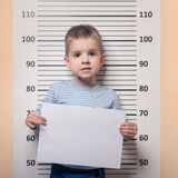 Littke boy against police line-up Stock Image