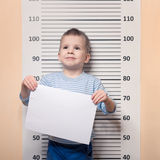 Littke boy against police line-up Royalty Free Stock Photo