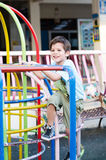 Littl boy climbing at playground Stock Photos