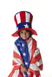 Littl boy dressed in a flag and hat from Uncle Sa Royalty Free Stock Images