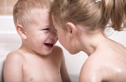 Littl boy and girl have fun in the bathtub. Brother and sister plays in the bathroom together Royalty Free Stock Photography