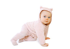 Littlbe baby playing crawls Royalty Free Stock Images