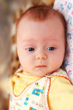 Little 4-months boy looking down Royalty Free Stock Photo