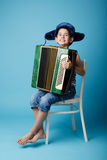 Little accordion player on blue background Royalty Free Stock Image