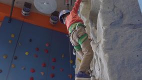 Little active boy climbing at indoor. Little active boy rock climbing at indoor gym stock footage