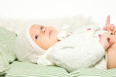 Little adorable baby in the bed Royalty Free Stock Photos