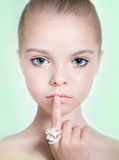 Little adorable fashion eight-year model girl with with a profe stock photos