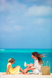 Little adorable girl applying sun cream to her mother nose Royalty Free Stock Photography
