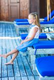 Little adorable girl on beach loungers near the Royalty Free Stock Photography