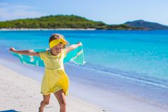 Little adorable girl with beach towel during Royalty Free Stock Images