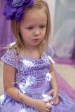 Little adorable girl in beautiful dress among Stock Image