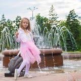 Little adorable girl in beautiful dress near Stock Photos
