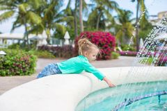 Little adorable girl in a beautiful exotic hotel Stock Photo