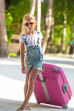 Little adorable girl with big luggage during Royalty Free Stock Photography