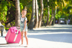 Little adorable girl with big luggage during Royalty Free Stock Image