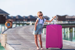 Little adorable girl with big luggage during Royalty Free Stock Images