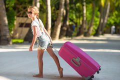 Little adorable girl with big luggage during Royalty Free Stock Photo
