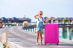 Little adorable girl with big luggage near water Royalty Free Stock Photography