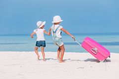Little adorable girl with big luggage during summer vacation stock photos