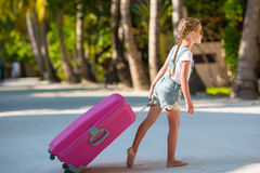 Little adorable girl with big luggage on tropical Stock Photography
