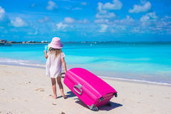 Little adorable girl with big suitcase on tropical Royalty Free Stock Image