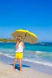 Little adorable girl with big yellow umbrella on Stock Image