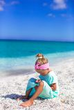 Little adorable girl with cell phone during beach Royalty Free Stock Photo