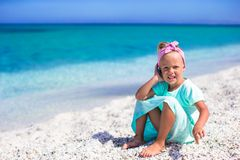 Little adorable girl with cell phone during beach Royalty Free Stock Photography