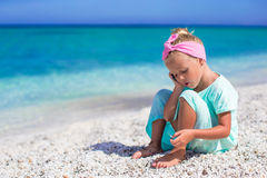 Little adorable girl with cell phone during beach Royalty Free Stock Images