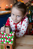 Little adorable girl decorating gingerbread house Royalty Free Stock Photography