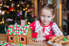 Little adorable girl with decorating gingerbread Royalty Free Stock Photo