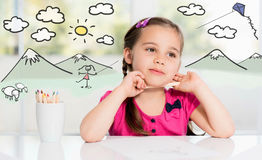 Little Adorable Girl Dreaming And Drawing Picture Stock Photo