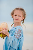 Little adorable girl drinking coconut milk on the beach Royalty Free Stock Photography