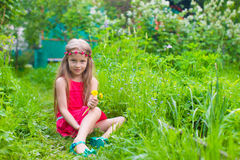 Little adorable girl enjoy sunny weekend in the Royalty Free Stock Photos