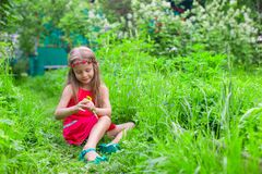 Little adorable girl enjoy sunny weekend in the Royalty Free Stock Photo